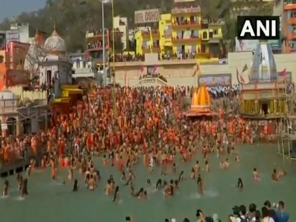 Sadhus of Juna Akhara participate in first 'Shahi Snan' of Kumbh Mela 2021
