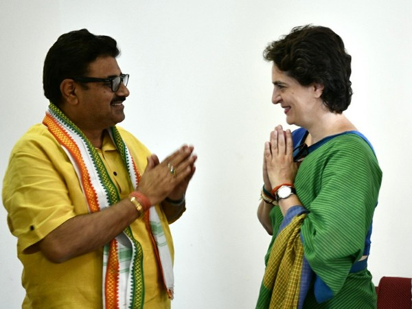 Ravi Dutt Mishra with Congress general secretary Priyanka Gandhi on Thursday. Photo/ANI