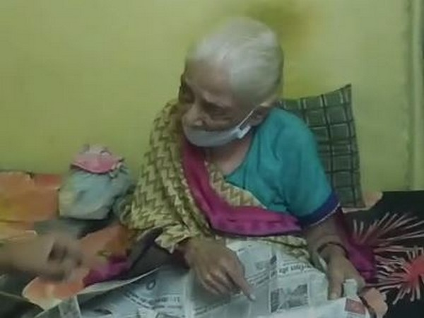 Chanda Bai sitting at her home after being recovering from coronavirus. Photo/ANI