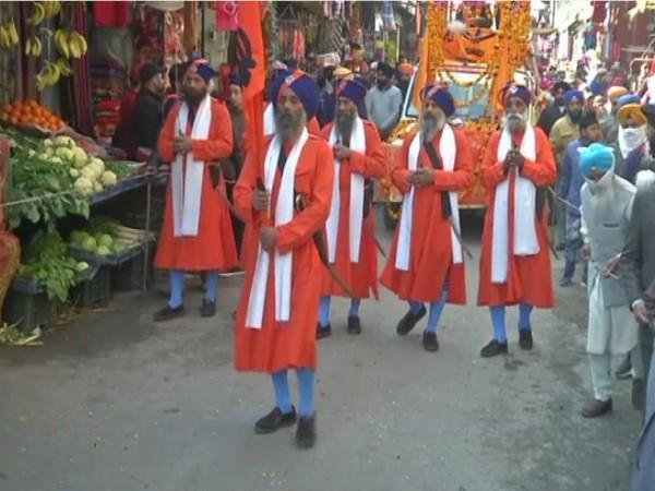 The District Gurudwara Prabandhak Committee organised 'Nagar Kirtan' on Guru Gobind Singh Jayanti in Poonch. [Photo/ANI]