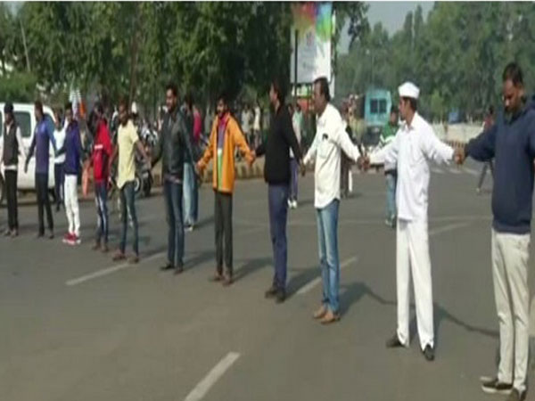People making human chain in Odisha to support a day a nationwide trade union strike (Photo/ANI)