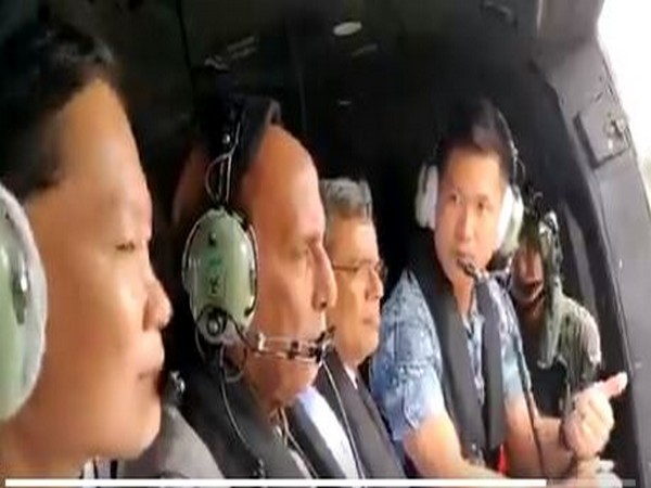 Defence Minister Rajnath Singh (second from right) along with Singapore air officials while taking familiarisation air sortie in Super Puma Helicopter of Republic of Singapore Air Force