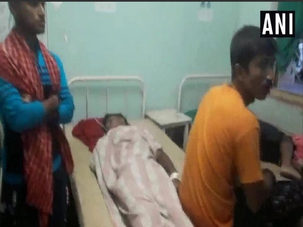 One of the injured in the temple stampede undergoing treatment at a hospital. (Photo/ANI)