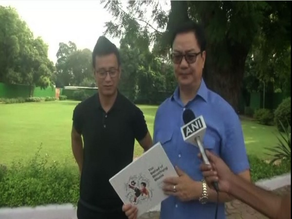 Union Minister for Youth Affairs and Sports Kiren Rijiju with Baichung Bhutia in New Delhi on Friday.