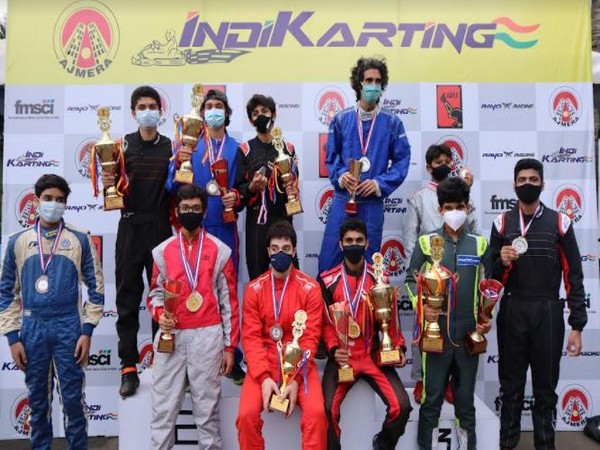 Champions of 'Ajmera Indikarting Clash of Pros' with their winning trophy