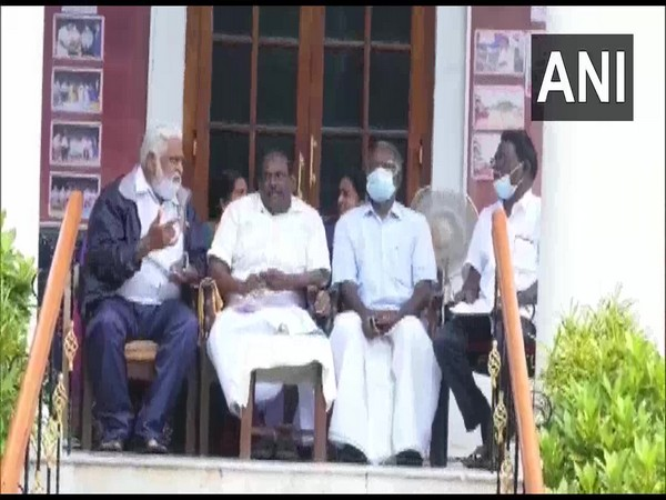 Puducherry Social Welfare Minister M Kandasamy sitting in protest outside the Assembly. (Photo/ANI)