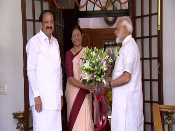 PM Narendra Modi with Vice-President Venkaiah Naidu and his wife M Usha at their official residence in New Delhi on Sunday. Photo/ANI