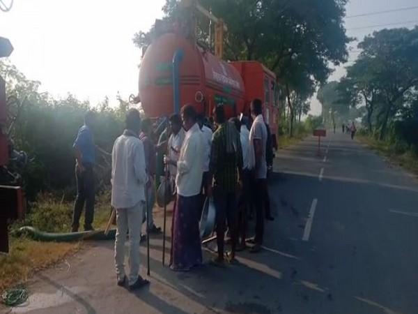 Locals gathered at Mullapadu village where petrol is leaking from HPCL pipeline on Wednesday. Photo/ANI