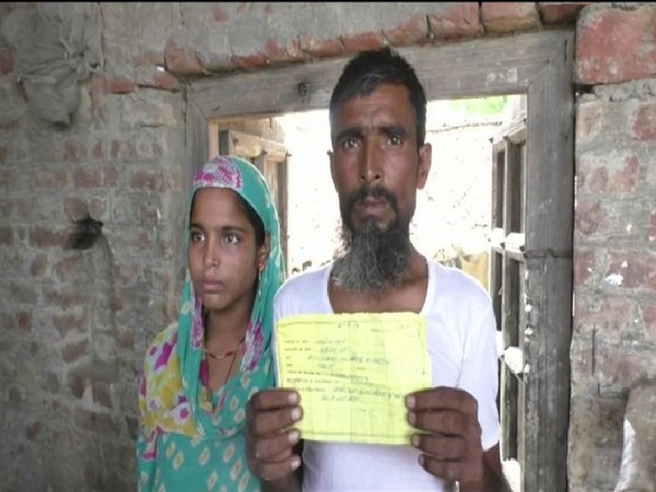 One of the affected woman with her father. Photo/ANI
