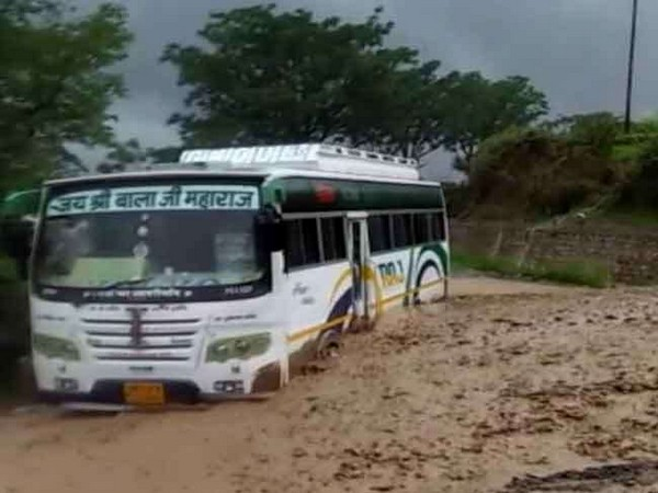 A bus stuck on a Badrinath Highway due to heavy rainfall on Saturday. [Photo/ANI]