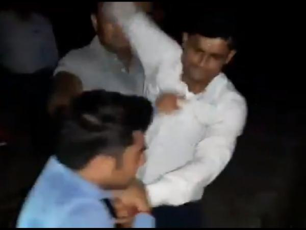 A still from the video of the assault on journalist which is going viral on social media.