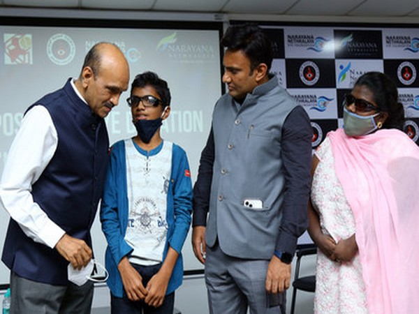 Karnataka Health Minister Dr K Sudhakar checking on young boy's vision as Dr K Bhujang Shetty, CMD of Narayana Nethralaya looks on, during inauguration of National programme on eye donation.