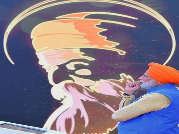 Prime Minister Narendra Modi posing before Guru Nanak Dev's painting in Punjab. Photo/ANI
