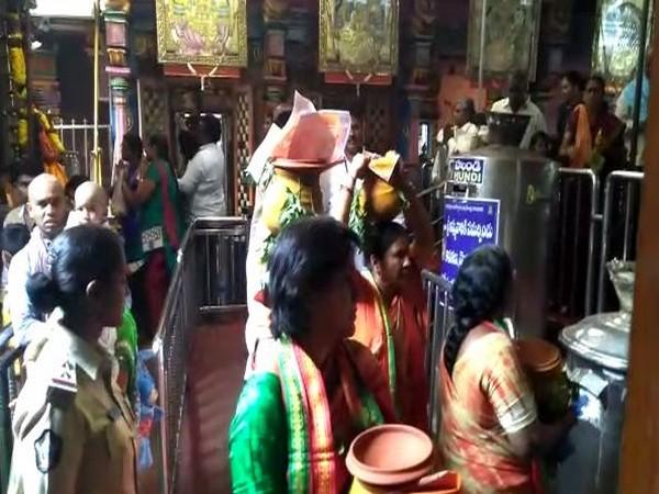 Women praying at Kanaka Durga Temple on Friday. Photo/ANI