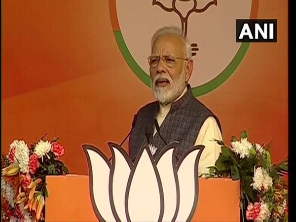 Prime Minister Modi addressing an election rally at Karkardooma in Delhi on Monday.