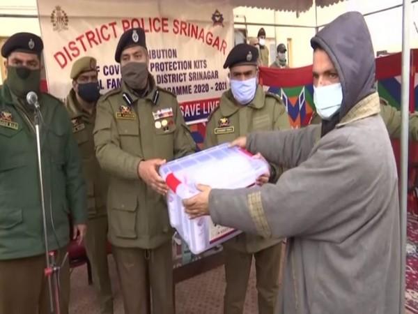 Srinagar SSP Dr. Haseeb Mughal distributing COVID-19 safety kits during an awareness camp on Friday. Photo/ANI