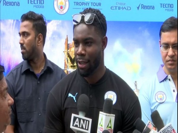 Former Manchester City player Micah Richards speaking to reporters in Mumbai on Friday. Photo/ANI