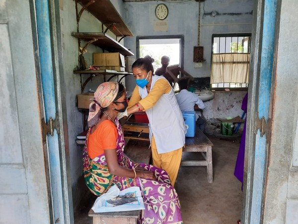 A tribal receiving a COVID-19 vaccine dose in Siliguri on Saturday. [Photo/ANI]