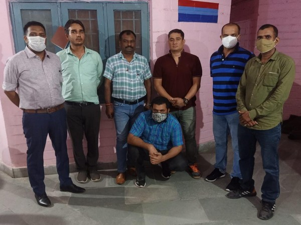 STF Uttarakhand Police with the criminal, Goraknath. (Photos/ANI)