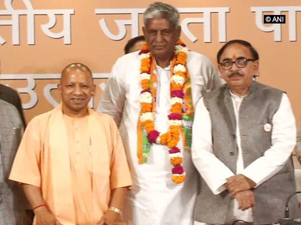 Uttar Pradesh Chief Minister Yogi Adityanath, Choudhary Virender Singh and state unit BJP president Mahendranath Pandey in Lukcnow on Saturday. Photo/ANI