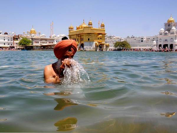 A sikh devotee takes a dip in the holy pond at the Golden Temple (Representative image)