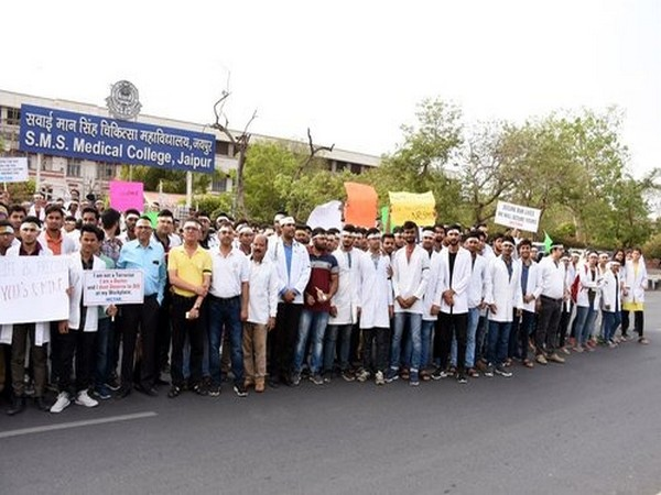 Medical staff protests against an alleged attack on a doctor in West Bengal, in Jaipur on Sunday. (ANI Photo)