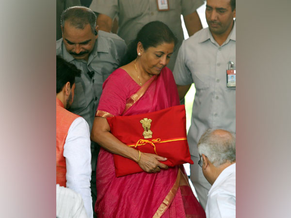 Finance Minister Nirmala Sitharaman reached Parliament with a red cloth Budget file on Friday.