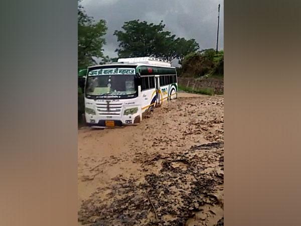 A bus got stuck near Pipalkoti on Badrinath Highway today following incessant rain in the region near Chamoli,[Photo/ANI]