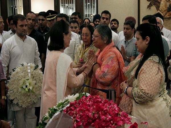 Congress interim president Sonia Gandhi with Arun Jaitley's wife Sangeeta Jaitley in New Delhi on Saturday. Photo/ANI