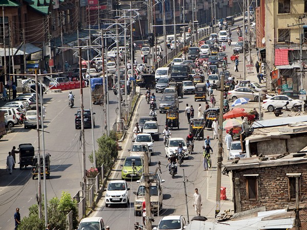 Vehicular movement on a busy road in Srinagar on Tuesday. Photo/ANI