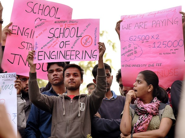JNU students holding placards during a press conference at JNU Campus in New Delhi on Tuesday.