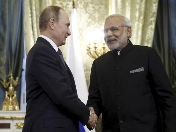 Prime Minister Narendra Modi and with Russian President Vladimir Putin