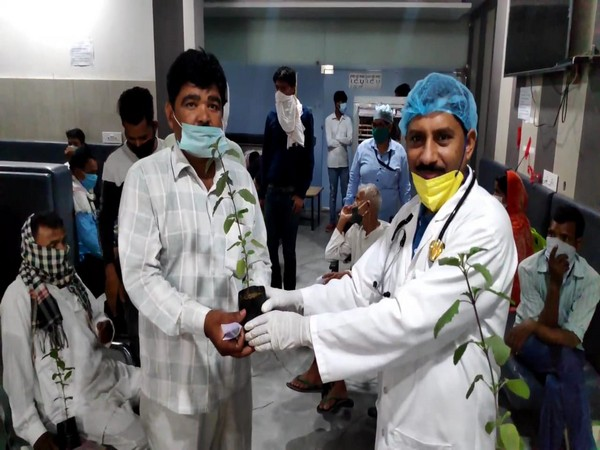 Dr CP Singh (left) giving plant to the patients on World Environment Day (Photo/ANI)