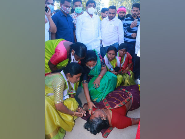 TRS leader K Kavitha helping unconscious woman on road. (Photo/ANI)