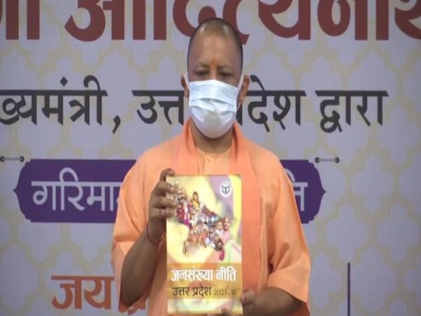 Uttar Pradesh Chief Minister Yogi Adityanath unveils the new population policy, in Lucknow on Sunday. [Photo/ANI]
