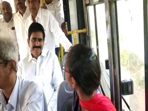 Former minister Devineni Umamaheswar Rao traveling from Vijayawada outskirts to Mylavaram in an ordinary bus on Wednesday. Photo/ANI