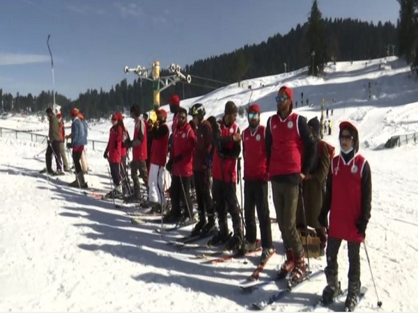 Young tourists learning skiing in Jammu and Kashmir's Gulmarg.