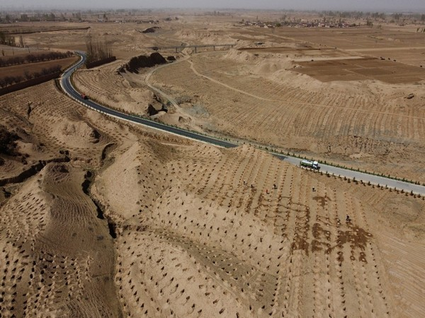 A village near the edge of the Gobi desert on the outskirts of Wuwei, Gansu province, China. (Picture credit- Reuters)