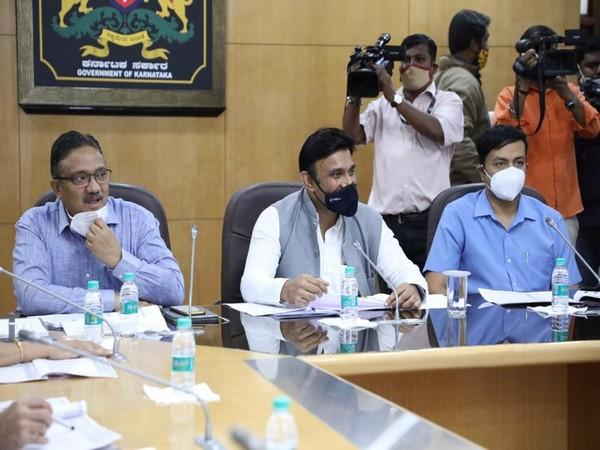 Karnataka health minister Dr K Sudhakar (Centre). (Photo/ANI)