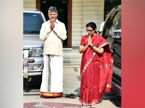 Andhra Pradesh Chief Minister N Chandra Babu Naidu, left, with his wife Nara Bhuvaneshwari offering prayers at their residence in Amaravati on Saturday. Photo/ANI