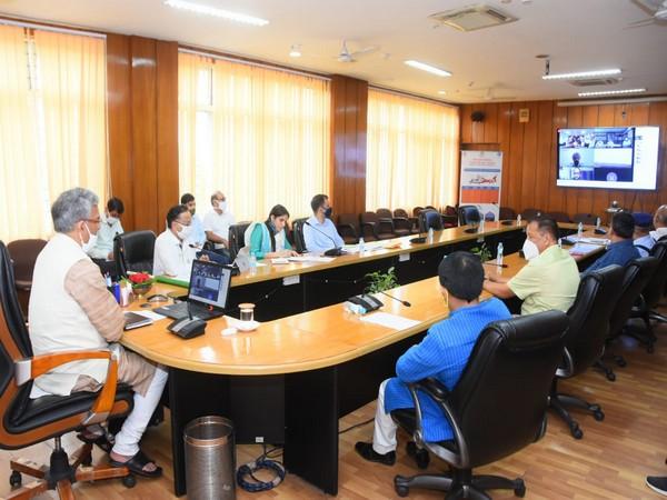 CM Rawat at a virtual meeting