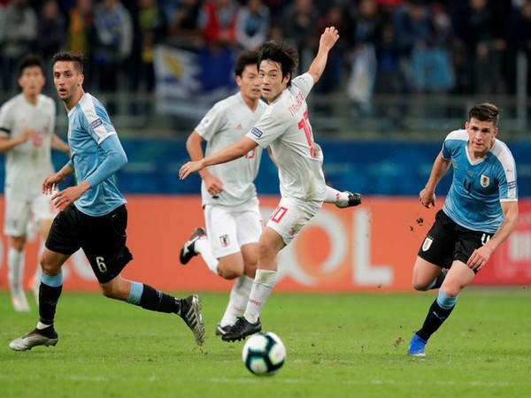 Players in action in the match between Japan and Uruguay