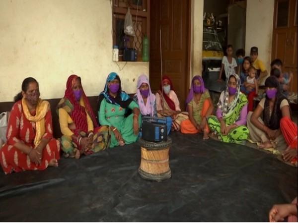 Women listing to community raido