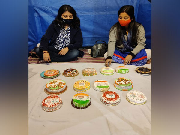 Piyali Sarker with her cakes with party symbol icing. (Photo/ANI)