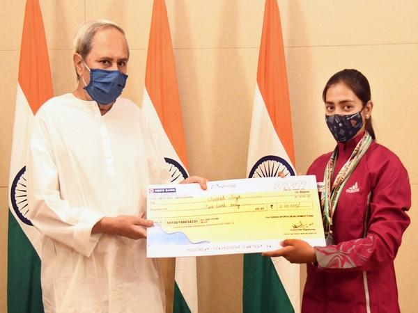 Odisha CM Naveen Patnaik (left) felicitates cyclist Swasti Singh (Photo/ANI)