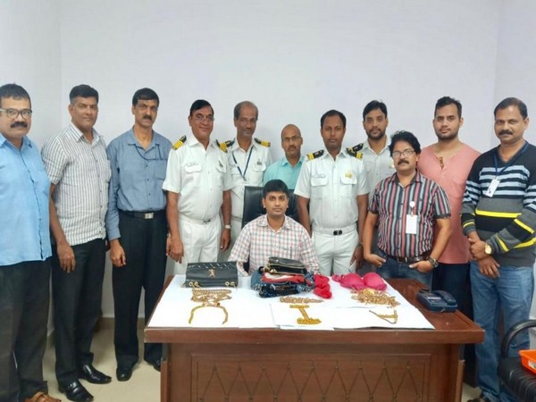 Goa Air Customs officials with the seized gold in Panaji on Sunday. Photo/ANI