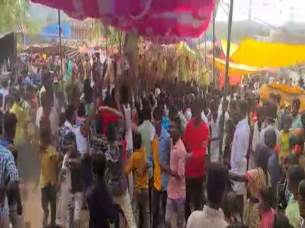 People seen violating COVID guidelines during a festivity in Anantapur. [Photo/ANI]