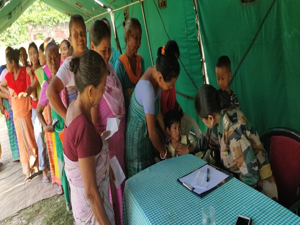 Locals being attended by army doctors in Chirang on Saturday. Photo/ANI