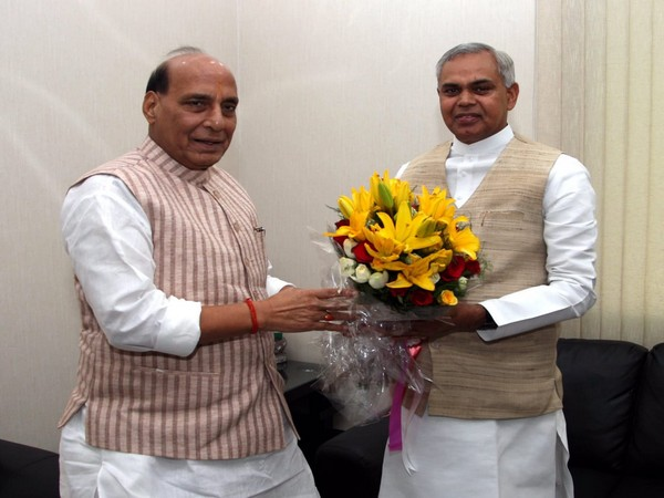 Union Defence Minister Rajnath Singh [L] with Gujarat governor Acharya Dev Vrat [R] in New Delhi [Photo/ANI]