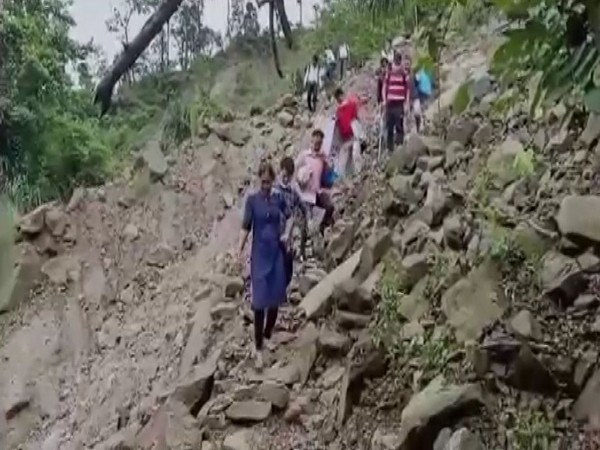 Alipurduar DM, health officials trek more than 10 kms to remote village in West Bengal for conducting COVID-19 vaccination drive on Sunday. [Photo/ANI]